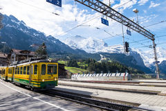 Train about to stop at Wengen station royalty free stock photo