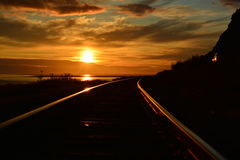 Train to the Sun. Picture taken at the Cook Inlet in Girdwood Alaska royalty free stock photography