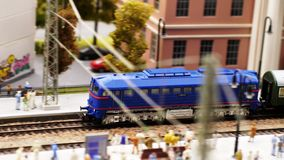 Train toy arrival at station in slow motion. 3840x2160. 4k stock video footage