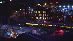 Train toy at night through the city with lights bokeh in slow motion. 3840x2160. 4k stock video footage