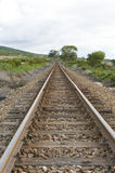 Train track. A well worn train track running through the countryside Stock Image