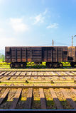 Train Track Cargo Carriage Sri Lanka Railways V. Side view of an old stationary rusted cargo carriage car sitting parked on train tracks, part of Sri Lanka Royalty Free Stock Image