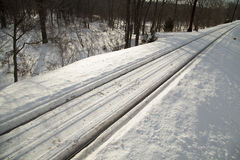 Train track covered with snow Royalty Free Stock Photo