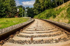 Train track and empty train station in small village. Photograph of a train track and empty train station in small village, Kryštofovo Údolí, Czech Republic Royalty Free Stock Photography