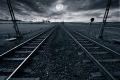 Train track and full moon Stock Photos