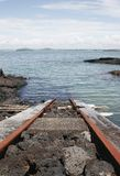 Train Track Into The Ocean Stock Image
