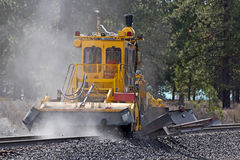 Train Track Maintenance Cleaning Equipment. Close-up of a railroad machine cleaning the train tracks stock photo