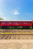 Train Track Passenger Carriage Sri Lanka Railway V. Side view of an old stationary red passenger carriage car sitting parked on train tracks, part of Sri Lanka Stock Images