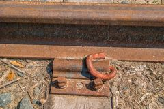 Train track rail with bolted plate royalty free stock image