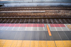 Train track railroad and waiting path Royalty Free Stock Images