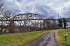 Train track railway bridge views along the Shelby Bottoms Greenway and Natural Area over Cumberland River frontage trails, Music C. Ity Nashville, Tennessee royalty free stock image