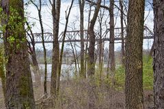 Train track railway bridge views along the Shelby Bottoms Greenway and Natural Area over Cumberland River frontage trails, Music C. Ity Nashville, Tennessee royalty free stock photo