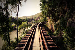 Train track with river and mountain view in Thailand Stock Images