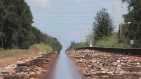 Train track during summer. Heat rises from railroad tracks in Florida stock footage