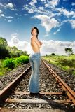 Train track topless. Topless model poses on train tracks stock image