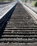 Train tracks. Parallel train tracks going off into the distance Stock Image