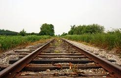 Train Tracks. Empty train tracks through the countryside Royalty Free Stock Photo