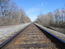 Train tracks. In winter in the woods Royalty Free Stock Image