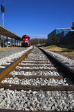Train tracks. Railroad single track going forth with blue sky and train Stock Photos