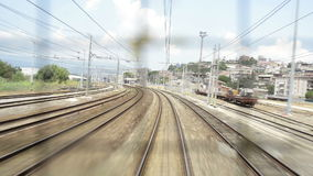 Train tracks that advances as seen through a window. Train running on Italian railroad tracks shooting from the wagon window stock footage