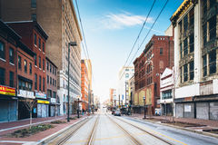 Train tracks along Paca Street in Baltimore, Maryland. Royalty Free Stock Image