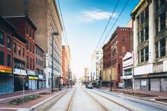 Train tracks along Paca Street in Baltimore, Maryland. Royalty Free Stock Image