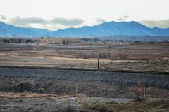 Train tracks around the Cradleboard Trail walking path on the Carolyn Holmberg Preserve in Broomfield with views of hiking trails,. By Denver Colorado, Rocky royalty free stock photo