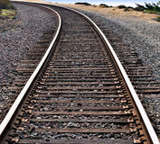 Train Tracks Around a Curve. Train tracks curving around the bend on an ocean cliff stock photography