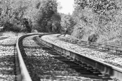Train tracks in a black and white autumn landscape Royalty Free Stock Photos
