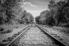 Train Tracks. A black and white perspective image of some train tracks Royalty Free Stock Photo
