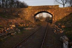 Train tracks through bridge Stock Images