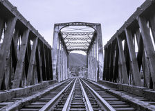 Train Tracks Bridge. Processed image of wooden & metal bridge with railroad tracks Stock Photography