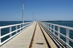 Train tracks on Busselton Jetty, WA, Australia.  Longest jetty in the southern hemisphere. Train tracks on Busselton Jetty, Western Australia, Australia royalty free stock photos