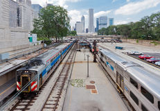 Train Tracks in Chicago. The train tracks with wagons leading towards the modern buildings of downtown Chicago, Illinois, United States Royalty Free Stock Photography