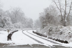Train Tracks Covered In Snow. Looking East along the railroad main line during a heavy, rare December 26th snow storm in South Carolina, USA Royalty Free Stock Photography