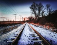 Train tracks covered in snow. stock images