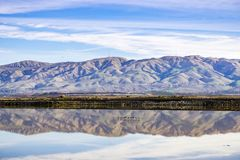 Train tracks crossing south San Francisco bay, Mission Peak and Monument Peak on the background, Alviso marsh, San Jose,. California royalty free stock images