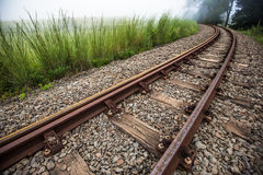 Train Tracks curves to the left Stock Photo