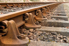 Train Tracks detail. Heritage rail road train tracks extreme close up and fading into distance stock photography