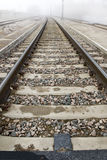 Train Tracks Disappear Into Fog 3 Stock Photos