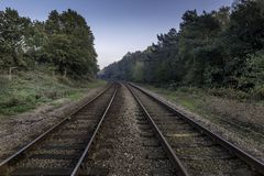 Train tracks disappearing into horizon. In Oulton Broad, Suffolk stock images
