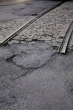 Train Tracks Ending. Train tracks coming to an end in a street Stock Photo