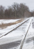 Train tracks. After first snow of the year Royalty Free Stock Photos
