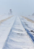 Train Tracks and Grain Elevator. In Blizzard Saskatchewan Royalty Free Stock Photos