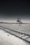 Train tracks and guard tower, Birkenau Concentration Camp, Poland Stock Image