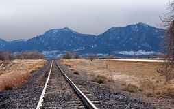 Train Tracks Head Towards Stormy Mountains Stock Images
