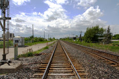 Train tracks. Heading west on the horizon a storm approaches Stock Image