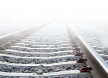 Train tracks in heavy fog. Going into the light royalty free stock image