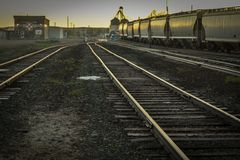 Free Train Tracks In Old Trainyard At Sunset Royalty Free Stock Image - 152348306