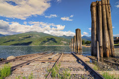 Train tracks by the lake Royalty Free Stock Photos